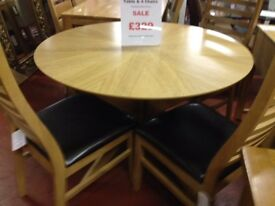 New round dining table with 4 new chairs only £329 in store now