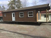 2011 Northlander Rustic Cabin 33ft with 6ft porch for sale. New!