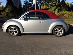 2009 Silver Volkswagen Beetle with Red Convertible Top