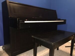 Apartment size piano with Bench