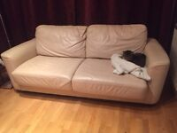 Cream leather-look sofa bed, comfy and in reasonable condition