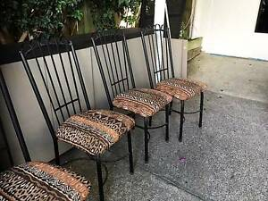 BLACK IRON CHAIRS WITH ANIMAL PRINT CUSHIONS Ashmore Gold Coast City Preview