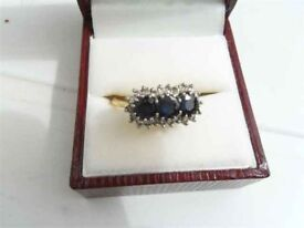 Large size 18 carat gold ring set with 3 large sapphires and 18 small diamonds to set it off.