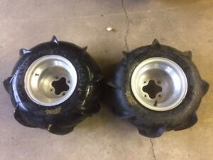 Rims and tires off of a 2005 TRX450R (20X11-9 and 20X10-9)