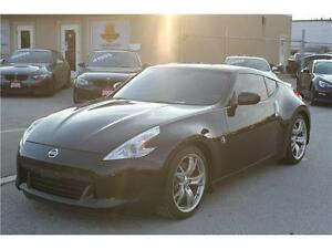 2009 Nissan  6 Speed Manual 100% Accident Free BLOW OUT SALE!