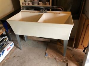 laundry room double sink with faucet
