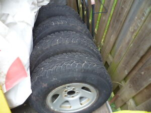 TIRES WINTER 225-75-15   90% TREAD