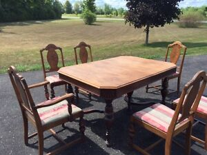 antique walnut diningroom table and 6 chairs