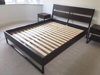 Lovely Ikea Trysil king sized bed. Great condition, clean home. Two Bedside tables included
