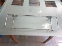 Shower shelf fitting with glass shelf and chrome frame and supports