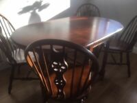 Vintage Solid Oak Table and 4 Wheel back Chairs