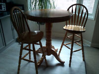 PUB TABLE AND TWO SWIVEL BAR CHAIRS