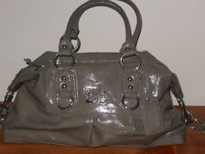 Gray coloured Coach Purse with lavender liner