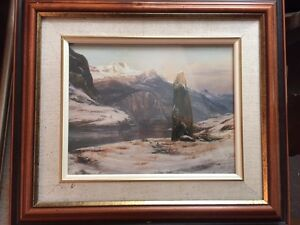 Framed Landscape painting of a rock in the mountains
