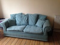 Comfortable green sofa in good condition -free to pick up!