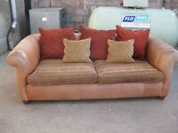 Tan leather and fabric 3 seater.
