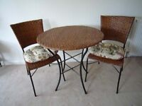 Rattan table and chair set, with seat pads