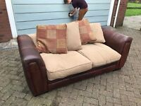 FREE - 2 seater sofabed - clean and in v good condition, brown leather arms & back with fabric seat