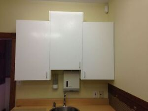 3 white cabinets