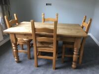 Farmhouse style solid pine (stripped) table and 4 chairs