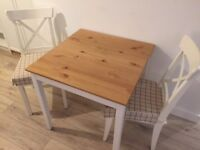 As new - wooden table and chairs - price dropped for sale this week!
