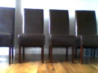 4 dark brown long back leather chairs