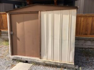 Free shed.  Must pick up in Canmore.