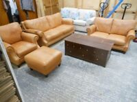 gorgeous 4 piece tan leather sofa suite. 1x 3 seater 1 x 2 seater, armchair and puffe. can deliver