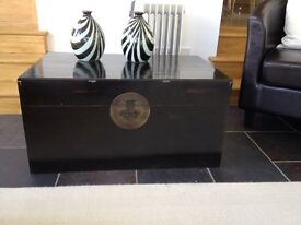 Two Oriental wooden trunks from OKA, black painted wood with ornate metal closures striking design