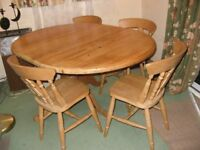 Extending circular pine table + 6 chairs