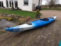 Sea Kayak complete with top quality paddle and spray deck