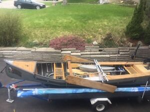 Sailing canoe with motor and trailer