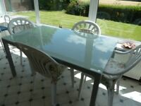 Scandi/Ikea style glass top table with metal legs (4 plastic garden chairs free of charge).