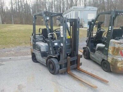 2006 Nissan 60 Forklift. Gray. 4750 Lb Lift Capacity. With Propane Tank.