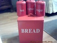Red metal bread bin and storage containers