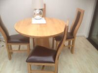 Oak table plus 4 chairs. Perfect condition as new. Brought for £800 oak furniture land.