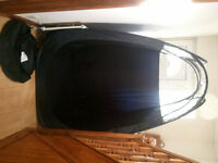 Black pop up tanning tent with clear top and zip area for tanning machine