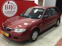Mazda 323 1.4 GXI (red) 2002