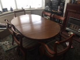 Beautiful twin pedestal yew dining table with four chairs and two carvers. COLLECTION ONLY from M32.