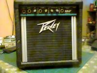 Peavey solo.Busking amp ,guitar and microphone,12volt car lighter, batteries and mains