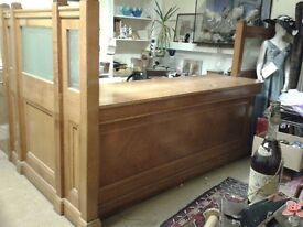 Antique solid oak counter top, oak and glass sides with glass door from Victorian bank building