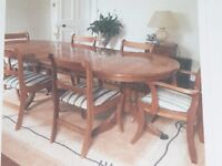 stunning yew wood dining table and 6 chairs