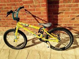Boys yellow BMX bike