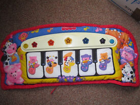 Fisher Price Kick and Play musical piano with lights for use in cot or on the floor