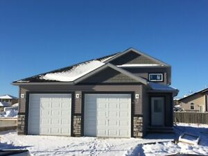 Upper and Lower Duplex with garage and utilities included!