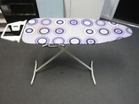 Ironing board with cover .