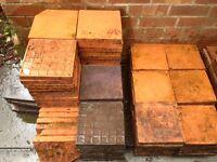 Terracotta/slate colored quarry tiles