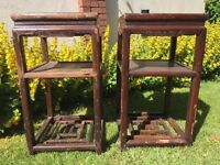 A pair of antique lamp tables