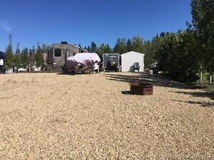 LARGE FULLY LANDSCAPED LOT AT RAYMOND SHORES!