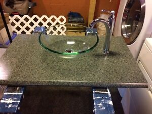 Green vessel sink, tap, and counter top